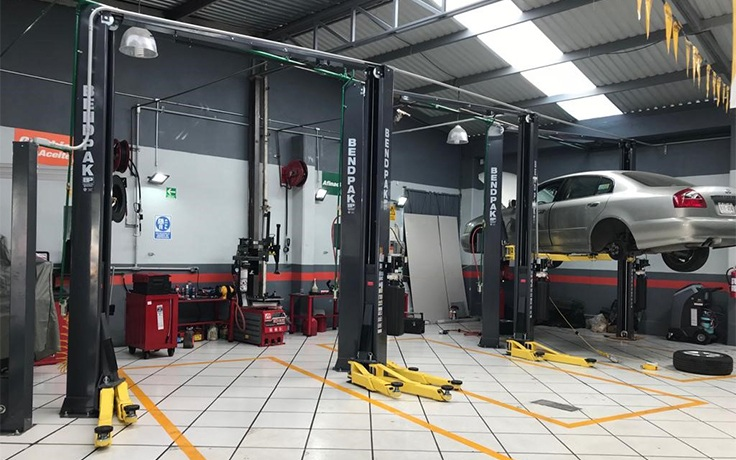 BendPak XPR-10AS 2-Post Lift in Auto Shop