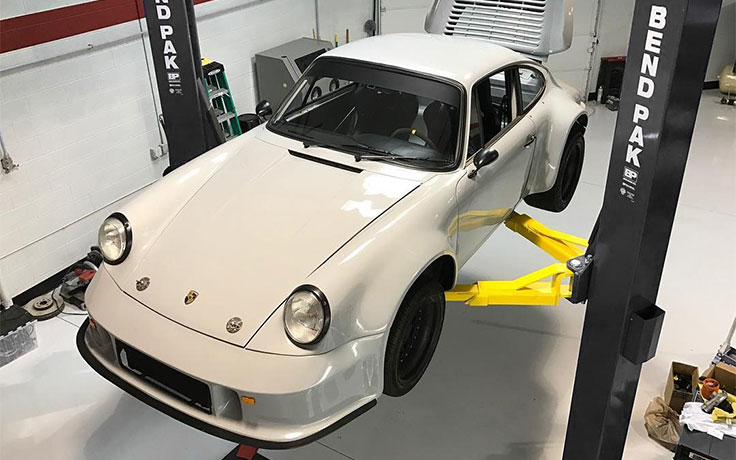 BendPak 2-Post Asymmetric Lift with Porsche